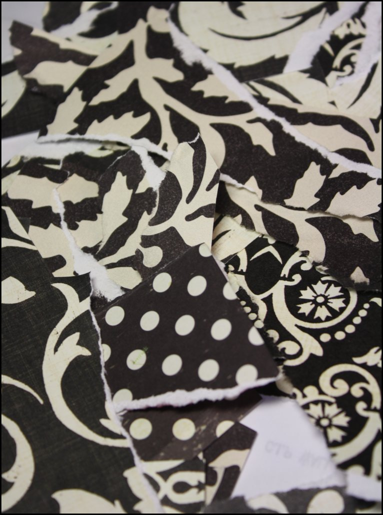 Torn scraps of black and cream papers
