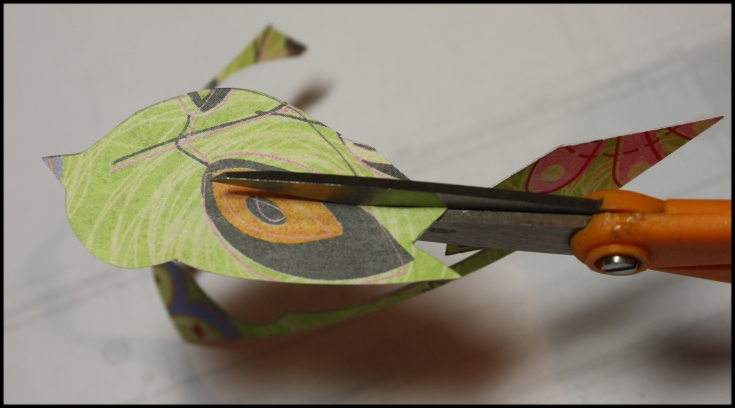 Cutting little paper birdies