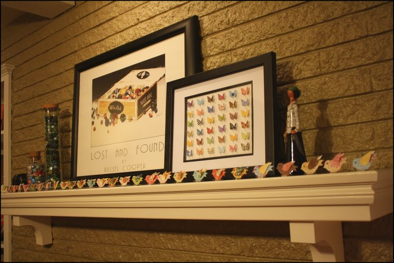 Paper birds on the mantle