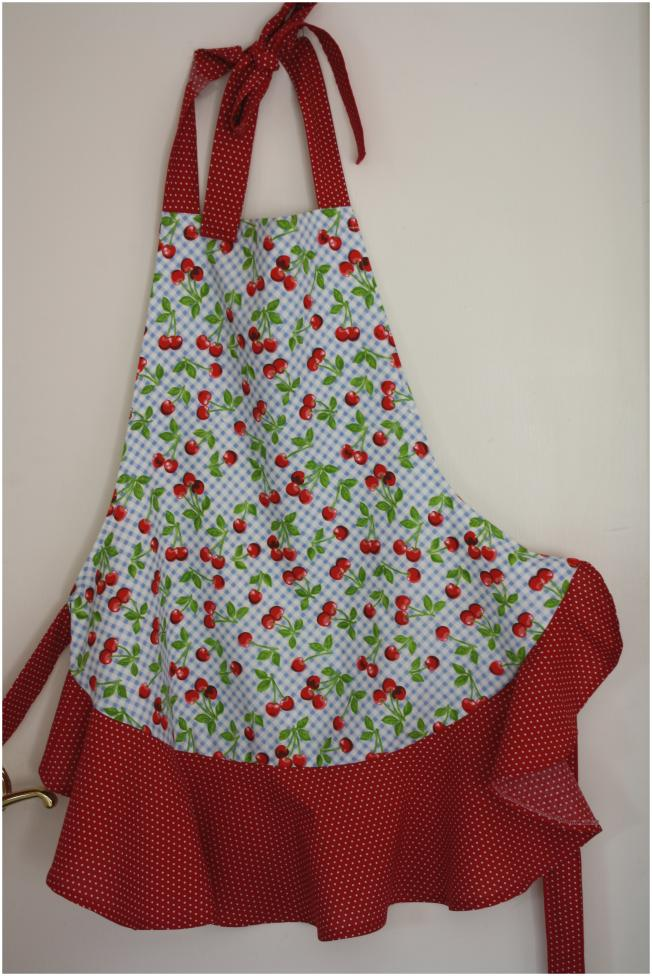 Blue gingham apron with cherries