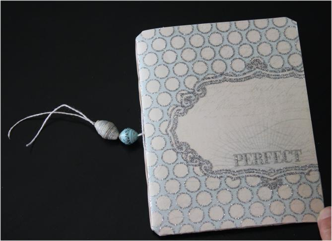 Rubberband book with paper beads added