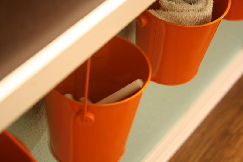 Closet-to-playspace after - mini bucket storage