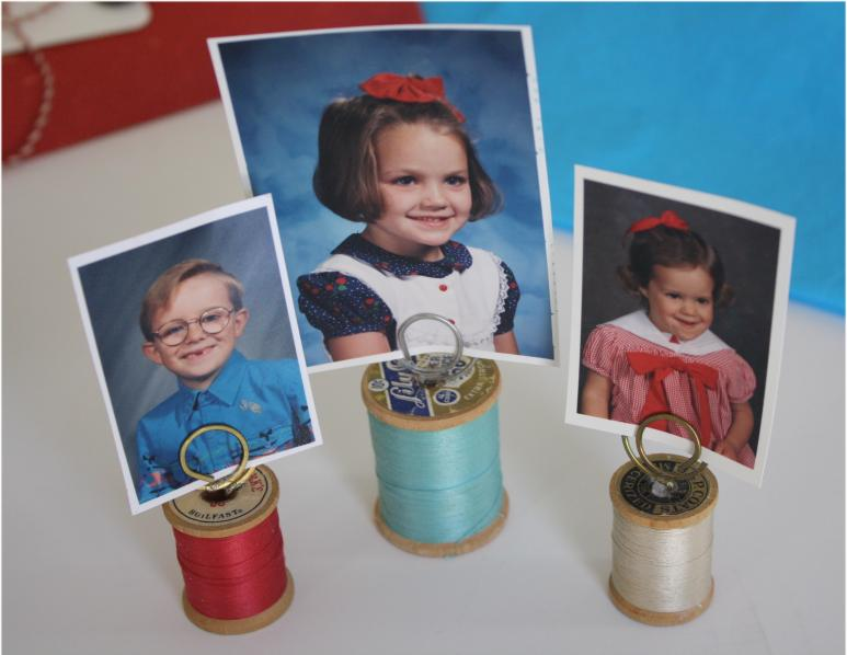 Photo holders made with spools and paper clips