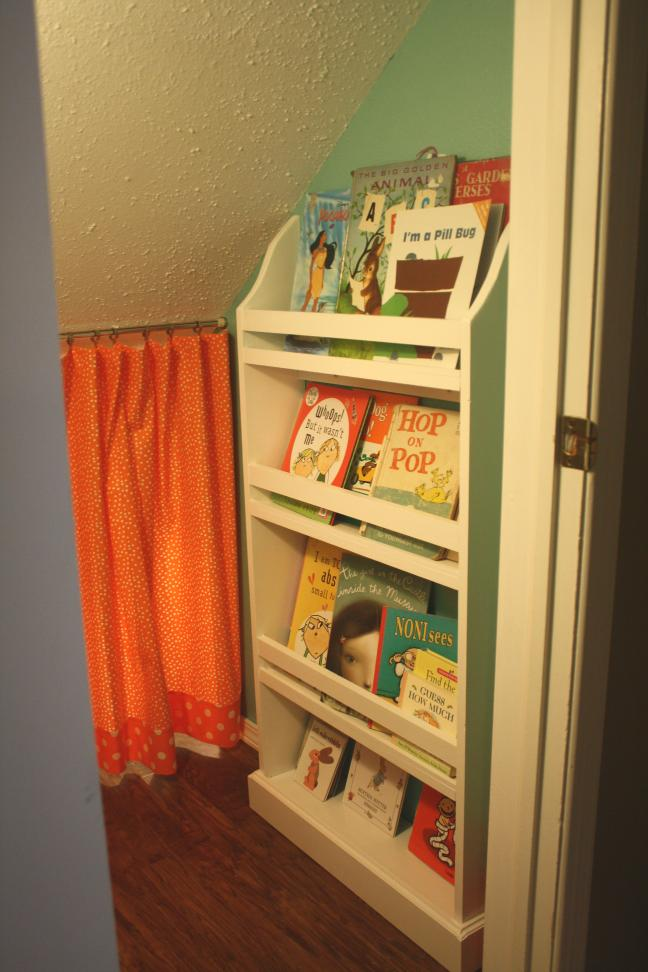 Closet-to-playspace after - forward facing bookshelf on the right side of doorway