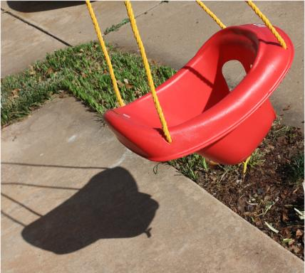 Child's Swing and Shadow