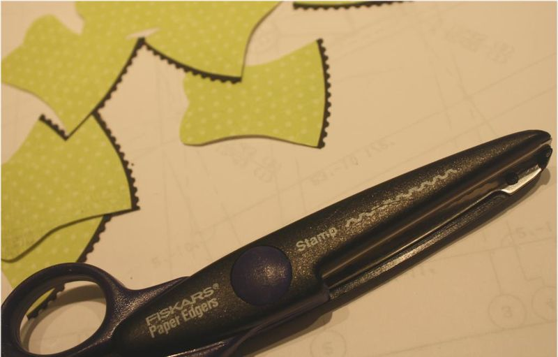 Using stamp-edge scissors to trim lingerie 4