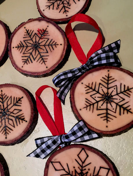 Woodburning ornaments from tree limbs